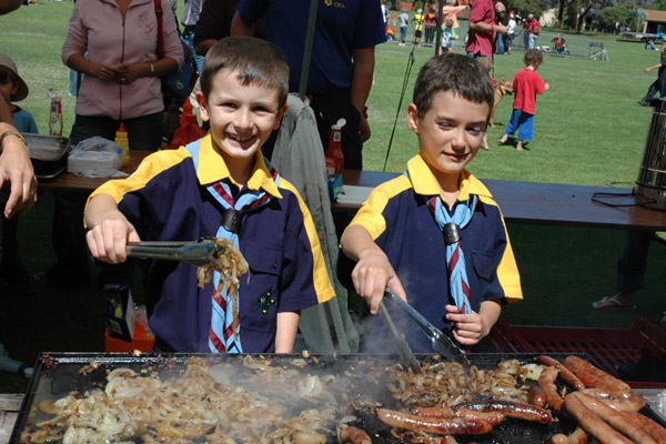 Cub scouts cooking sausages